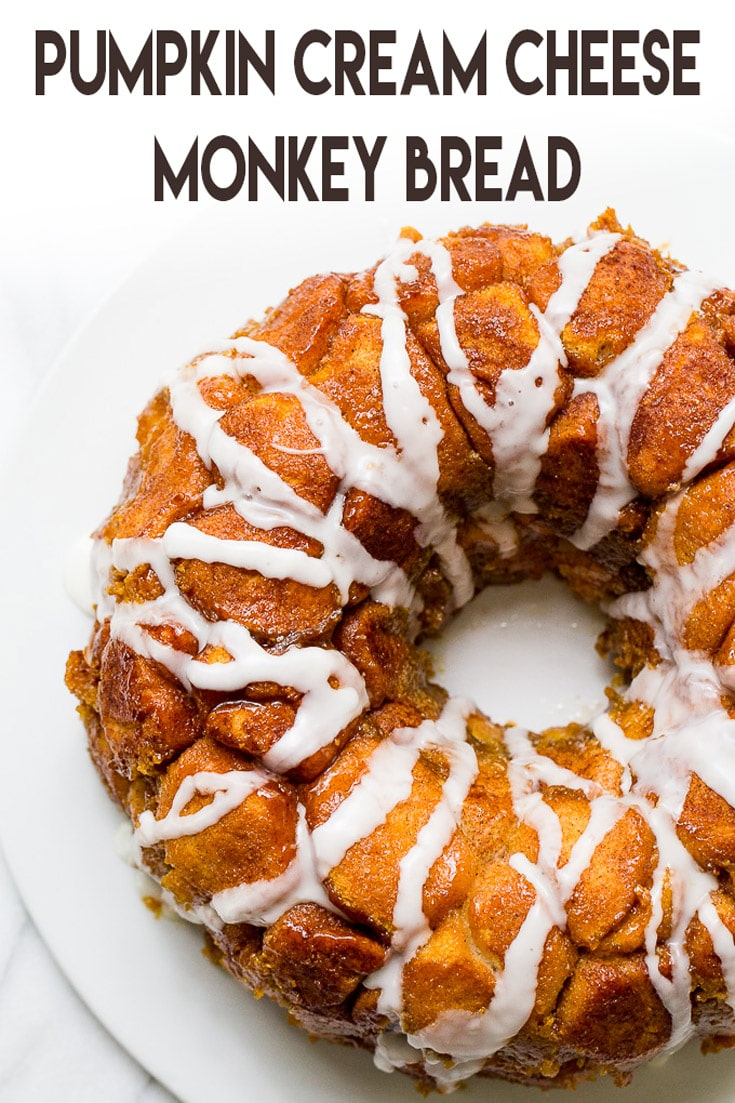 An easy to make monkey bread with warm pumpkin pie spices and cream cheese in every sweet bite! #monkeybread #recipe #pumpkinrecipe #pumpkindessert #pumpkinmonkeybread #pullapartbread
