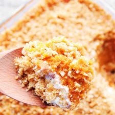 sweet potato casserole on a wooden spoon.