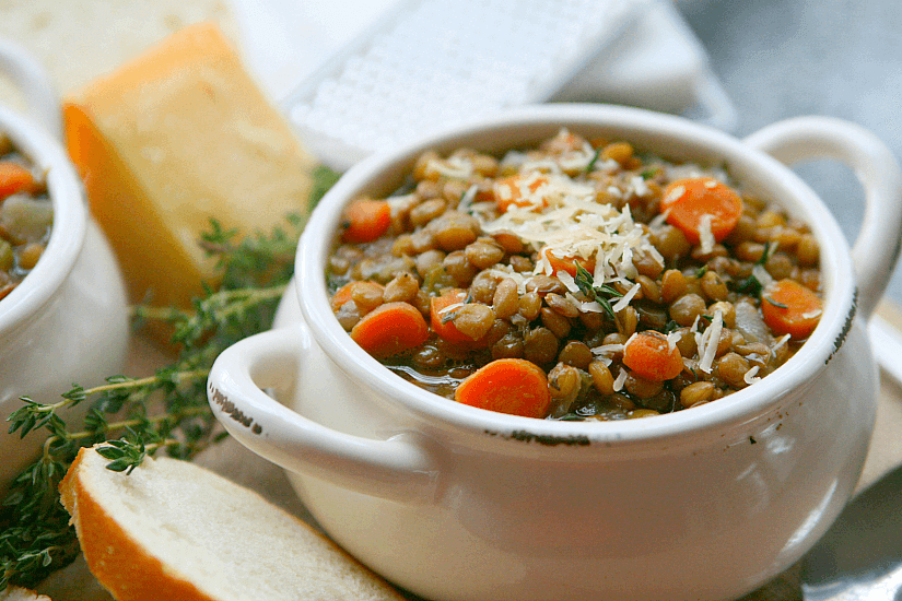 Lentil soup with grated cheese on top.