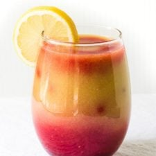 strawberry mango banana smoothie in a glass