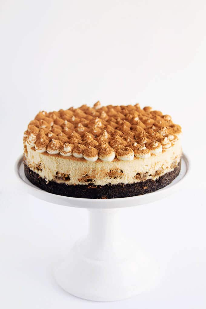 Tiramisu Cheesecake on a cakestand.