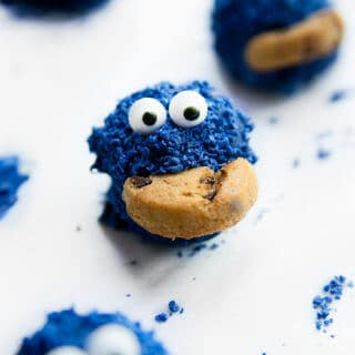 A cookie monster oreo ball on a plate.