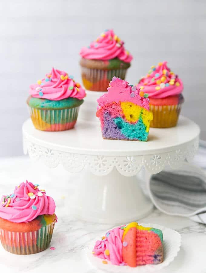 rainbow cupcakes on a cakestand