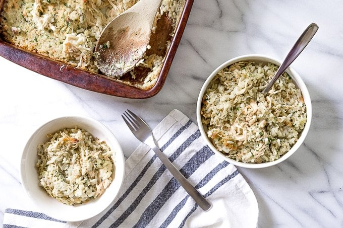 Two bowls of chicken and rice casserole on a table.
