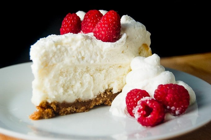 Vanilla Bean Cheesecake with raspberries.