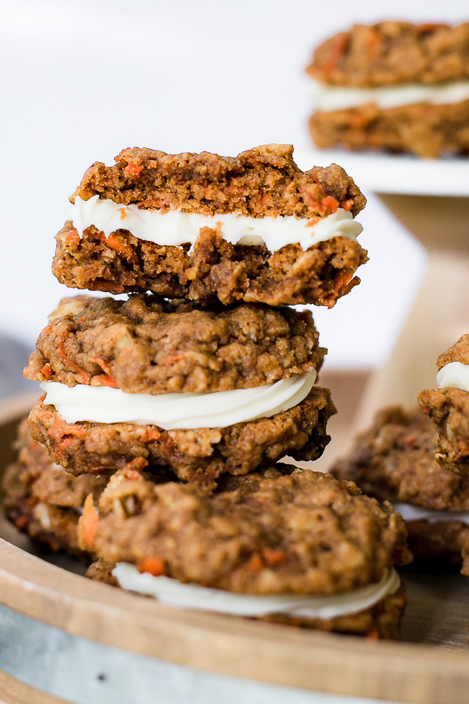 3 carrot cake whoopie pies stacked on each other.
