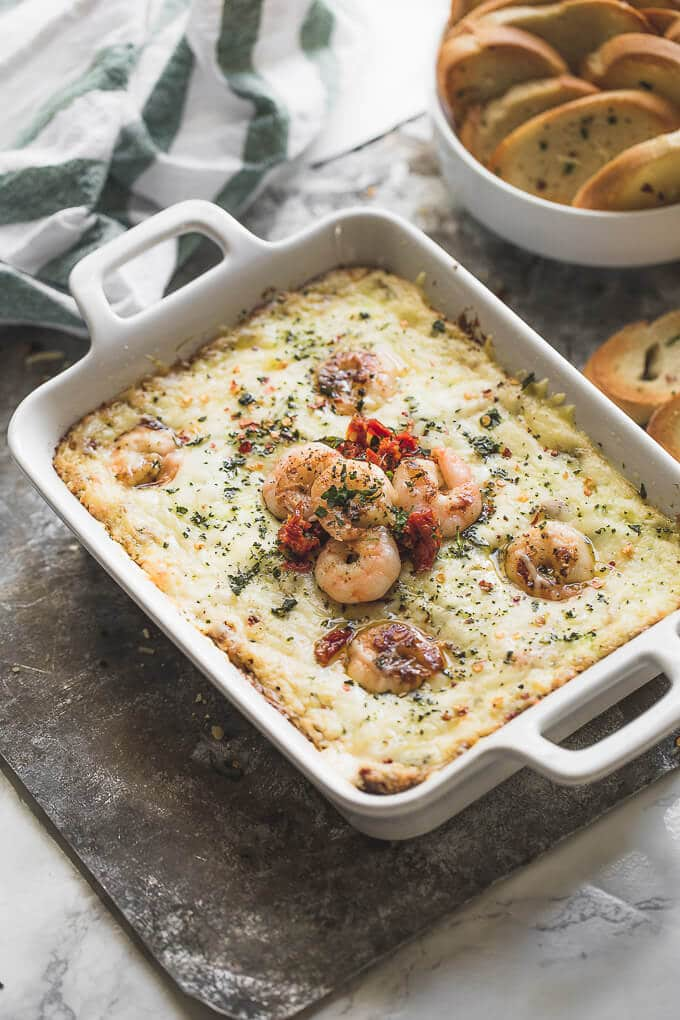 Garlic Butter Tuscan Shrimp Dip ... um yes please! So flavorful. Easy party appetizer! | AmyintheKitchen.com