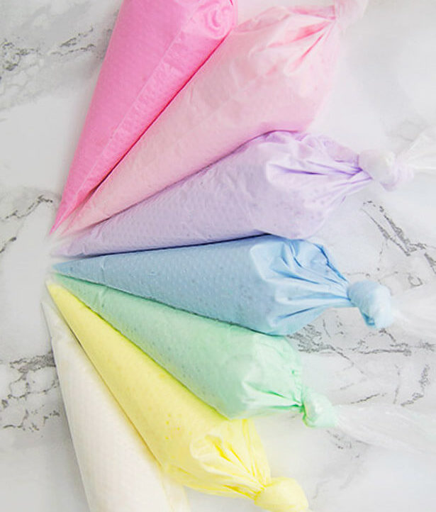 Piping bags with different colors of royal icing.