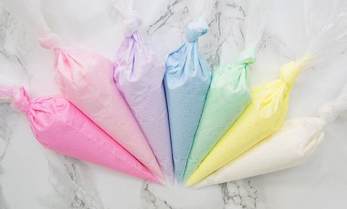 Piping bags with different colored royal icing.