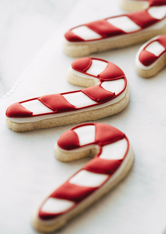 candy cane sugar cookies on a piece of parchment.