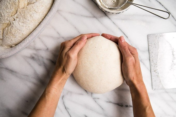 Hands showing how to shape the dough into balls.