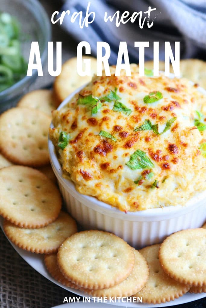 crab meat au gratin with crackers on a plate