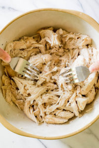 easy crockpot shredded chicken in bowl