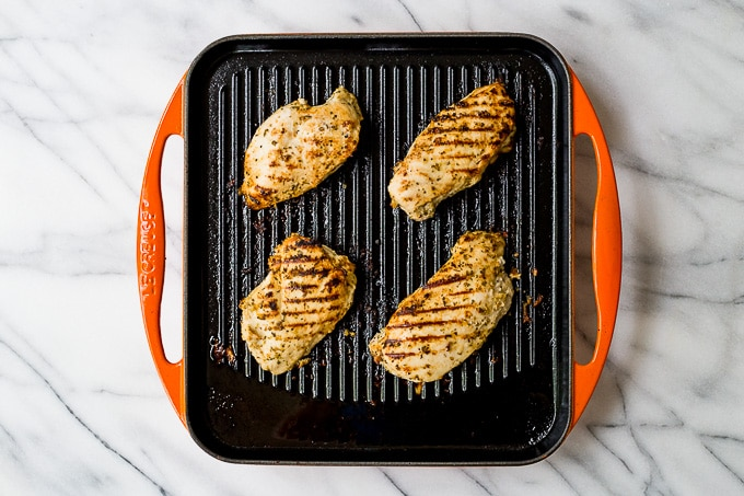 greek chicken on a grill.