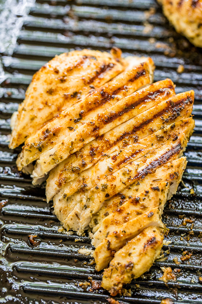 piece of grilled chicken breast cut into slices.