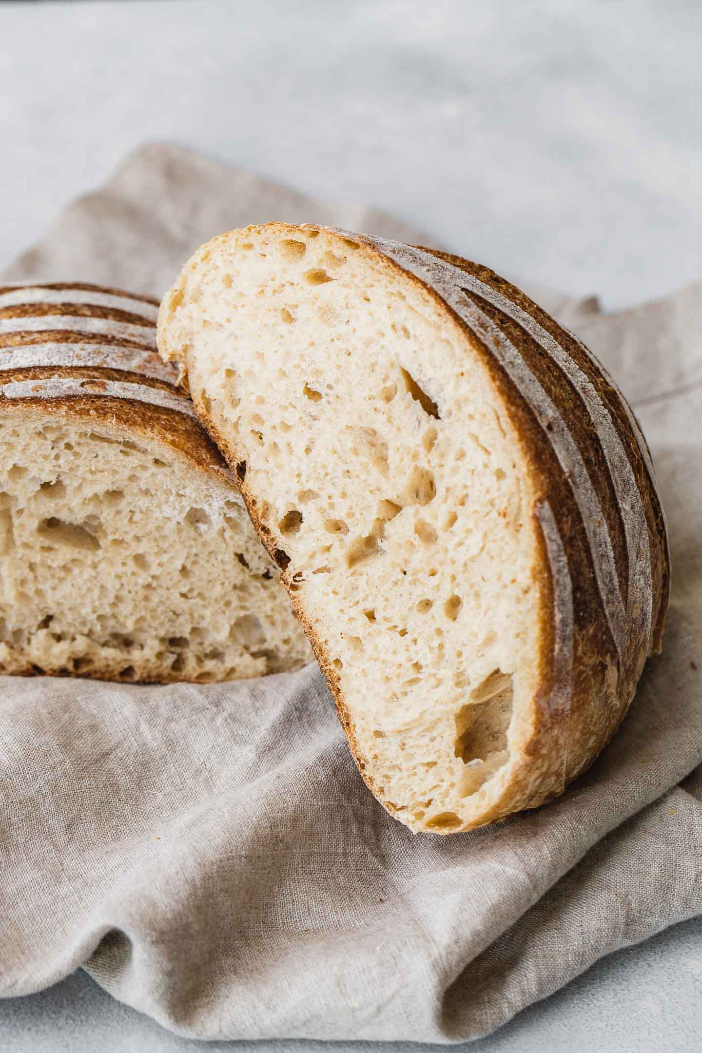 A loaf of sourdough bread cut in half.