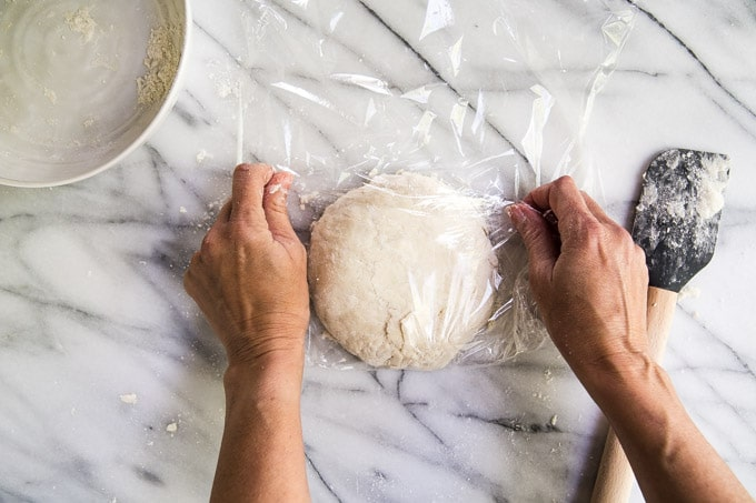 wrapping pie dough in plastic wrap