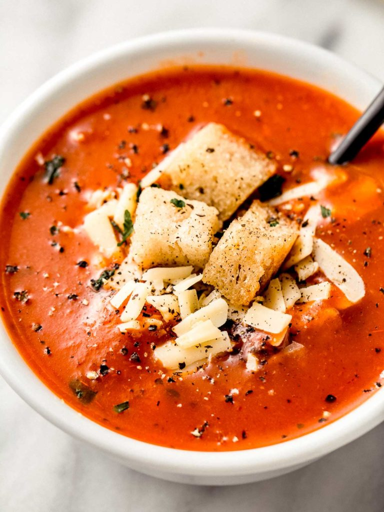 Homemade tomato soup in a bowl with croutons.