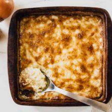 hot onion dip on a cracker