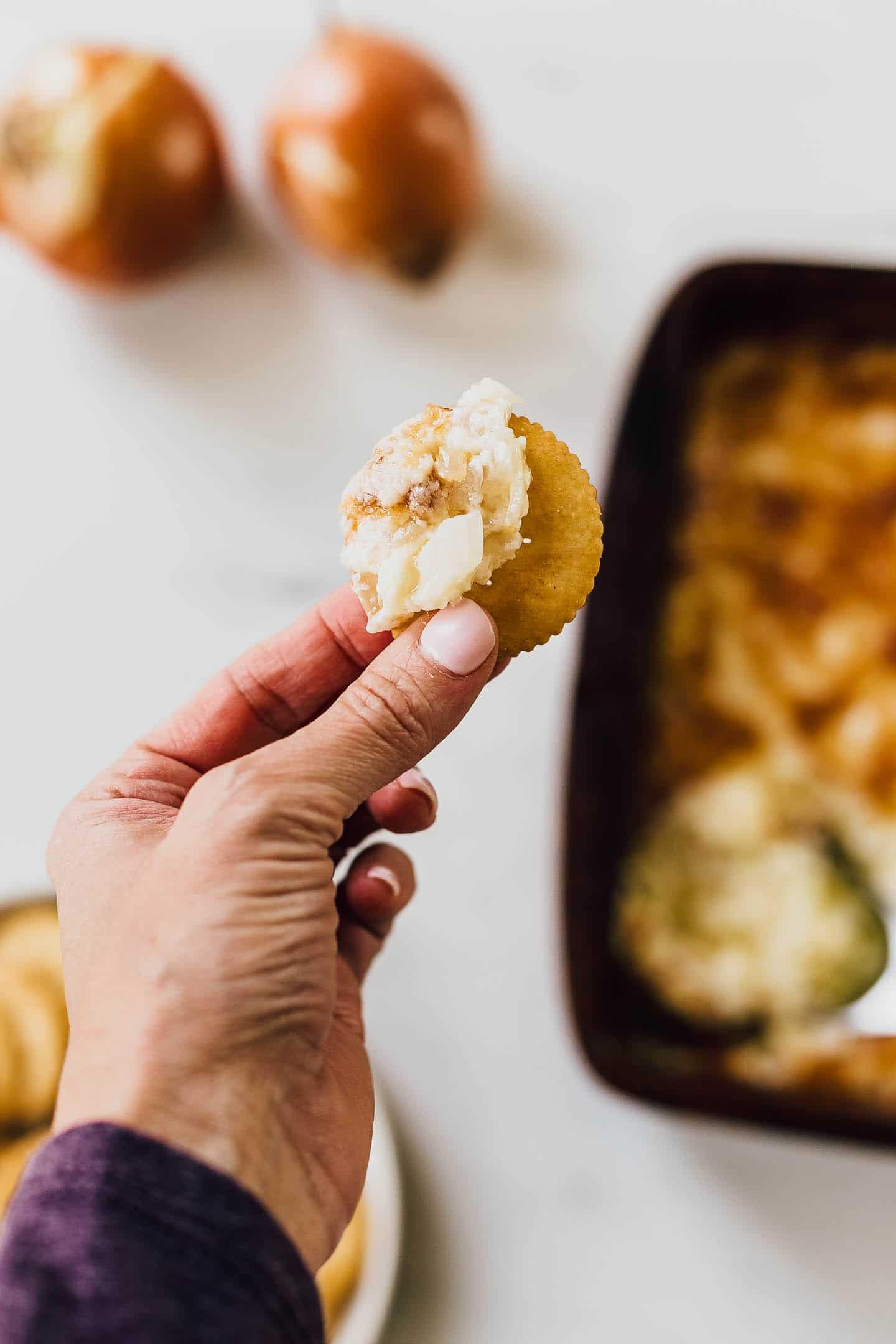 hot onion dip on a cracker.