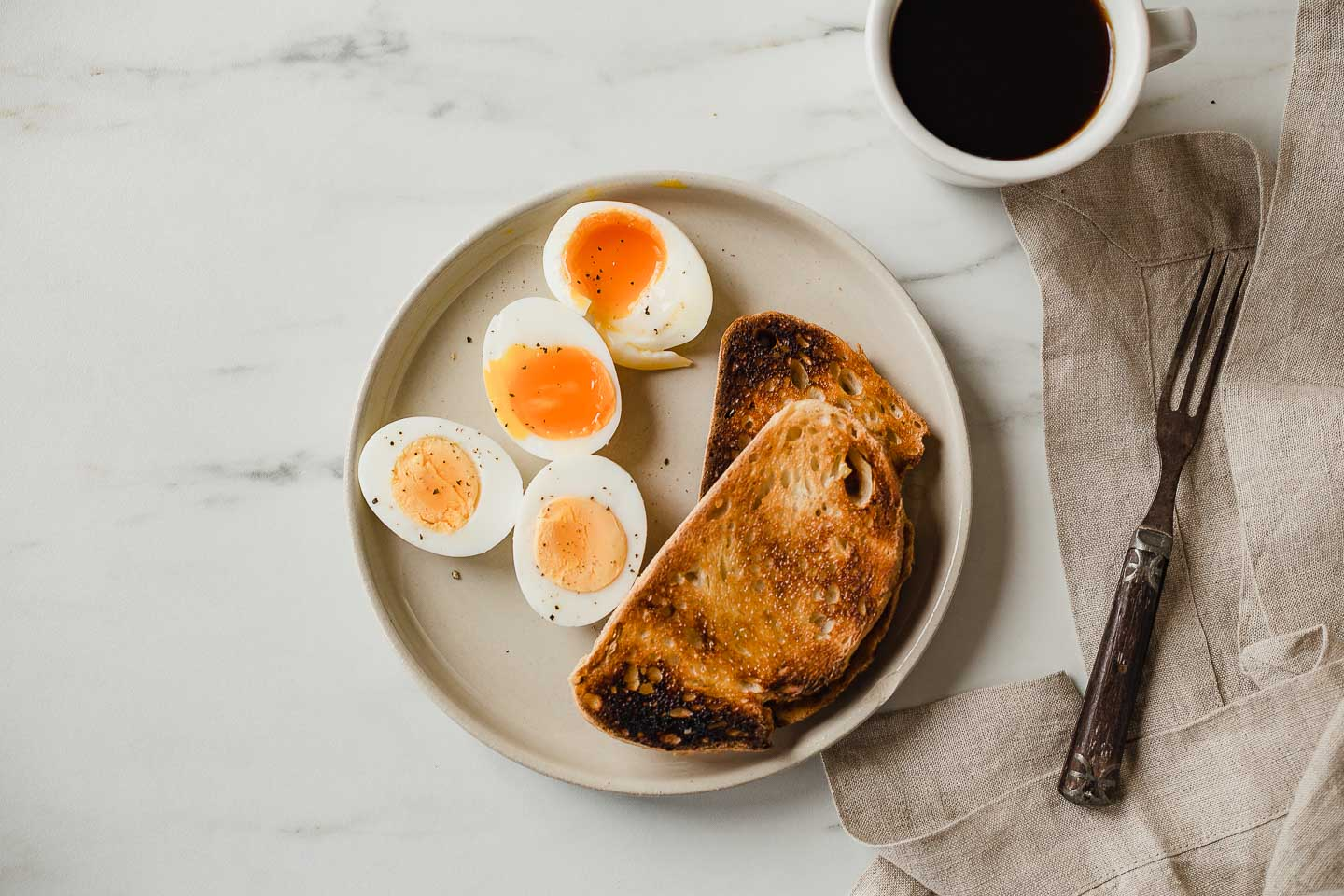 soft boiled eggs and hard boiled eggs on a plate with toast
