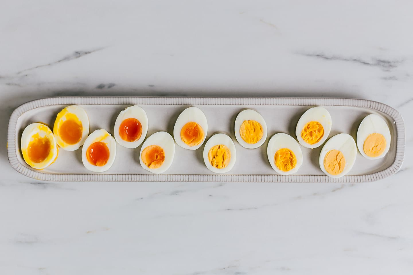 a tray of soft boiled eggs and hard boiled eggs