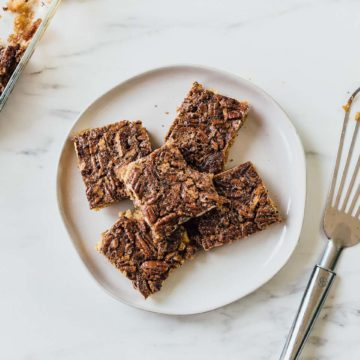 pecan pie bars on a plate with spatula
