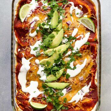 sweet potato enchiladas topped with cilantro avocado and sour cream
