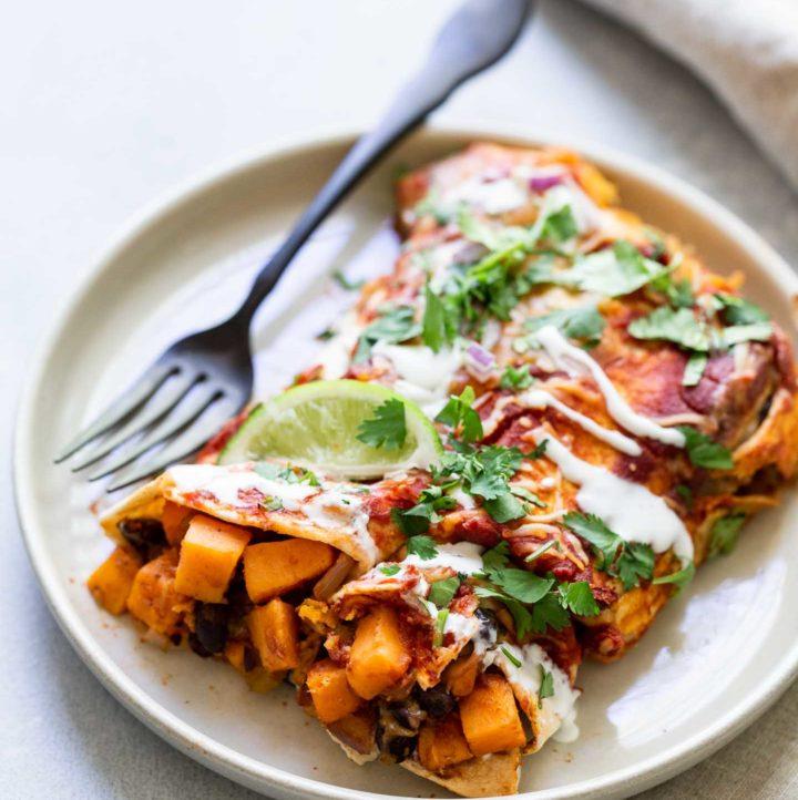 sweet potato enchiladas on a plat