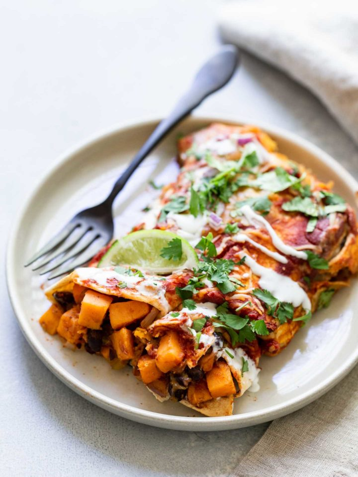 sweet potato enchiladas on a plat