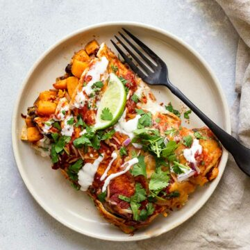 sweet potato enchiladas on a plate with a fork and napkin