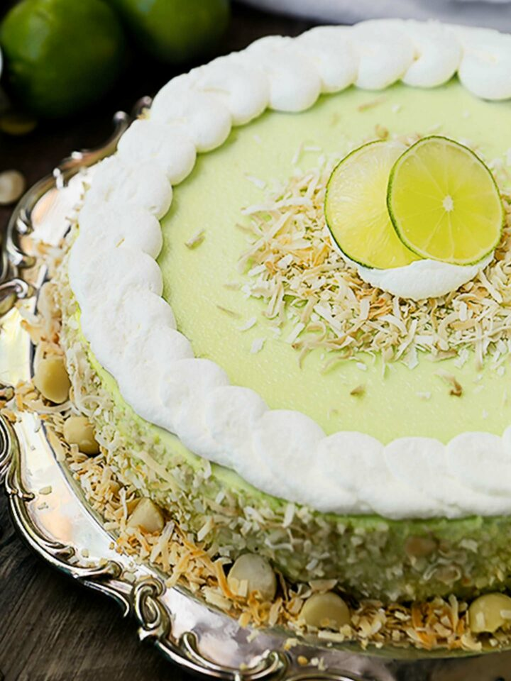 key lime cheesecake with whipped cream and toasted coconut