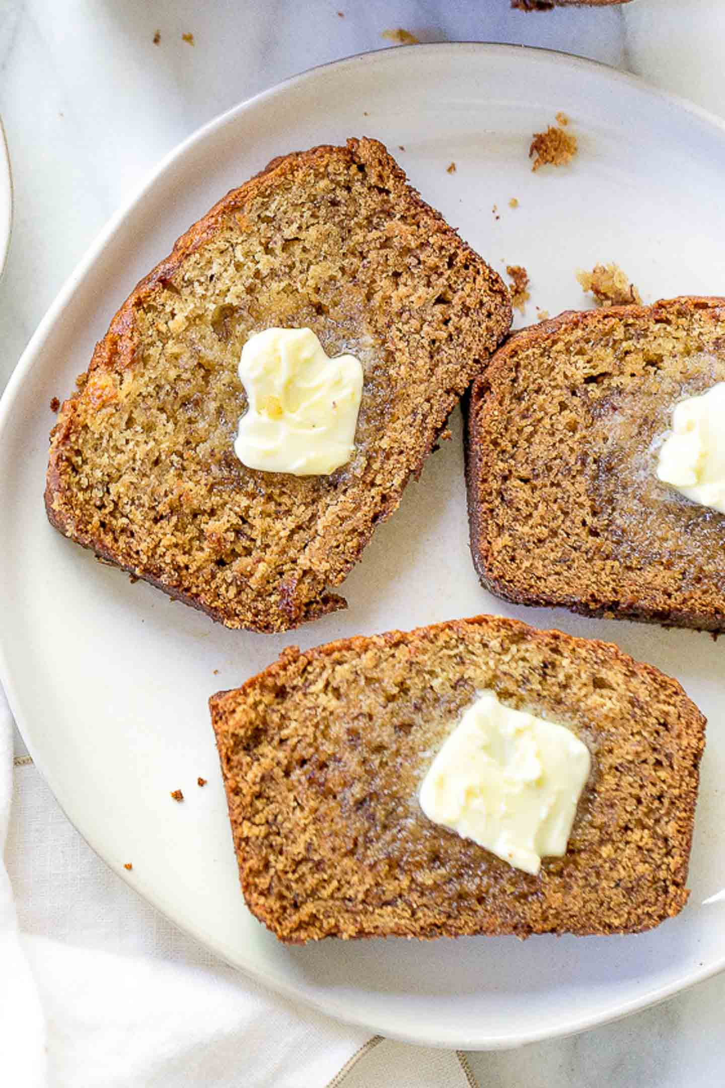Slices of banana bread with melted butter.