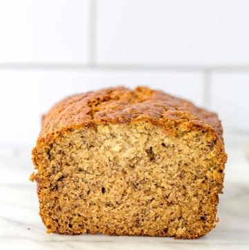 a loaf of banana bread with a slice cut out