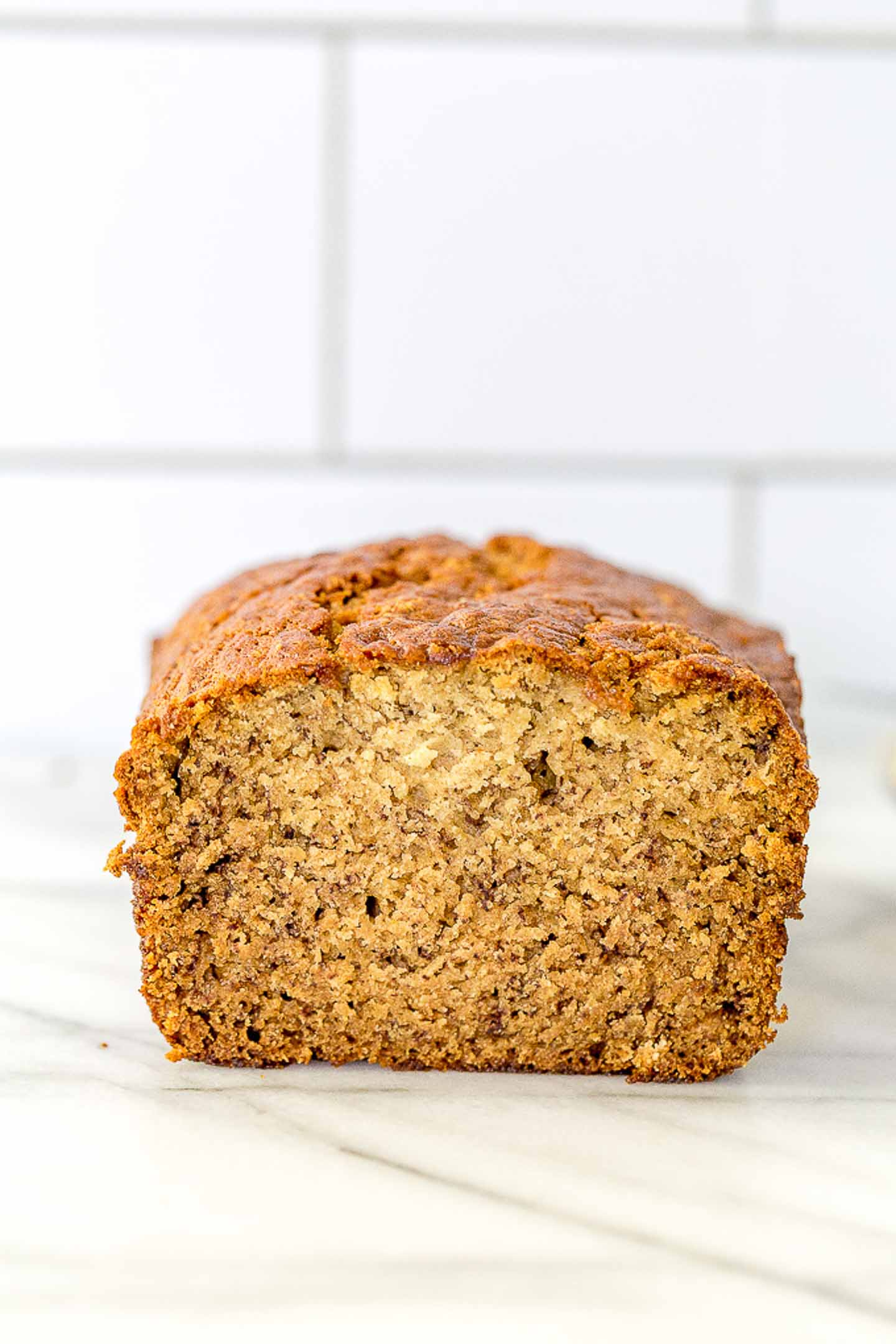 a loaf of banana bread with a slice cut out.