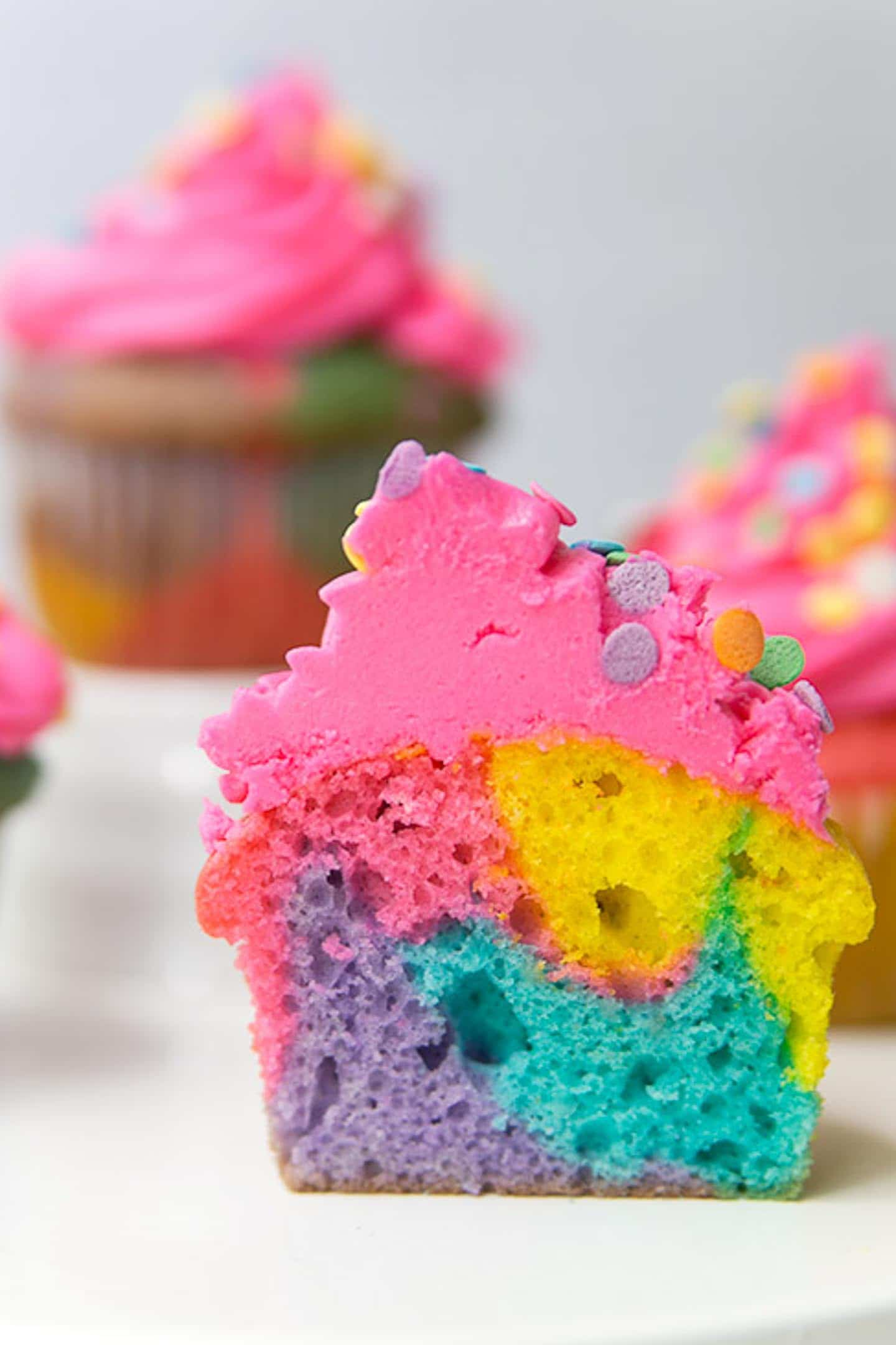 rainbow marble cut in half to see the inside of the cupcake