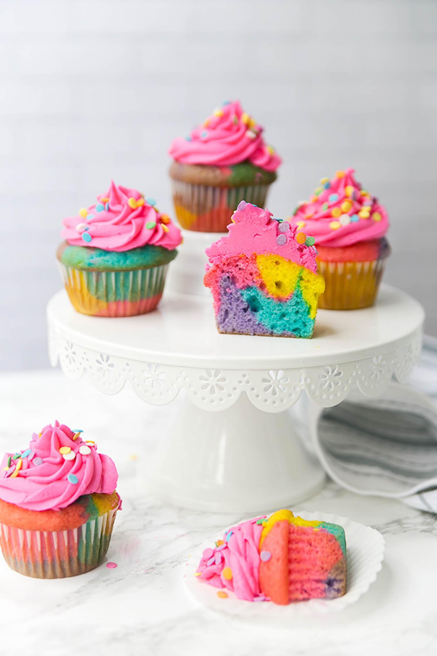 Rainbow marble cupcakes on a cakestand.