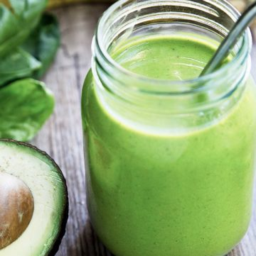 Green Smoothie in a mason jar with a straw.
