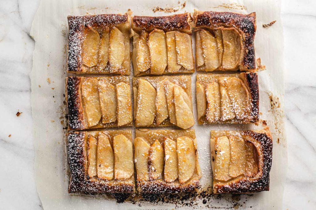 apple tart cut into nine squares.