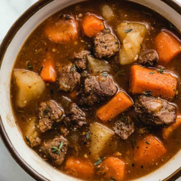 closeup photo of a bowl of instant pot beef stew.