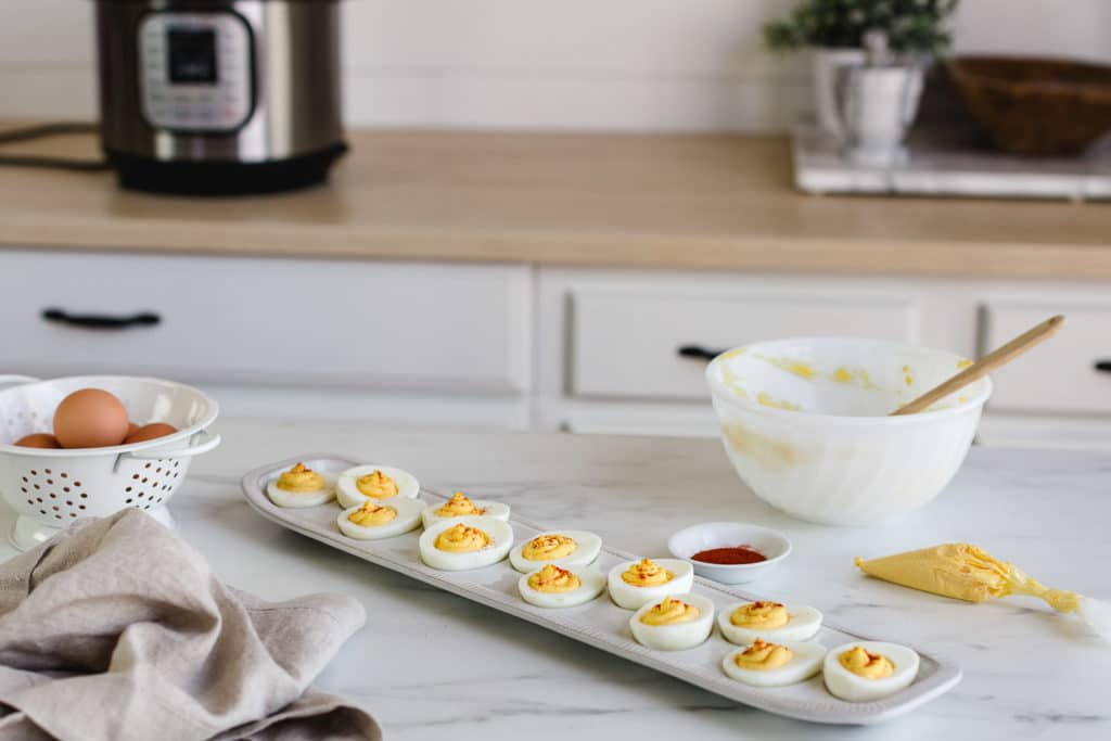 deviled eggs on a kitchen counter top.