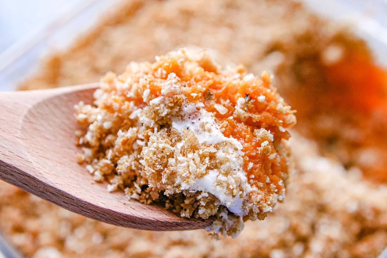 A scoop of sweet potato casserole on a spoon.