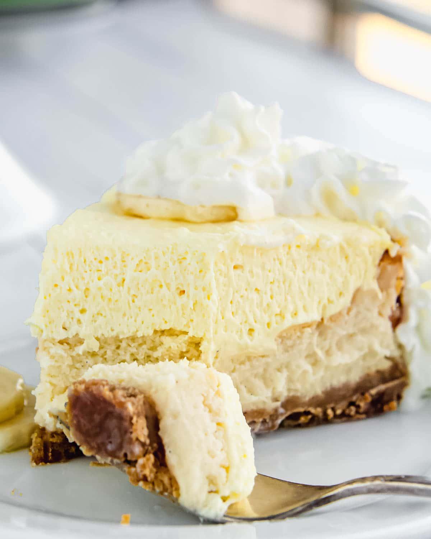 Banana cream cheesecake with whipped cream.