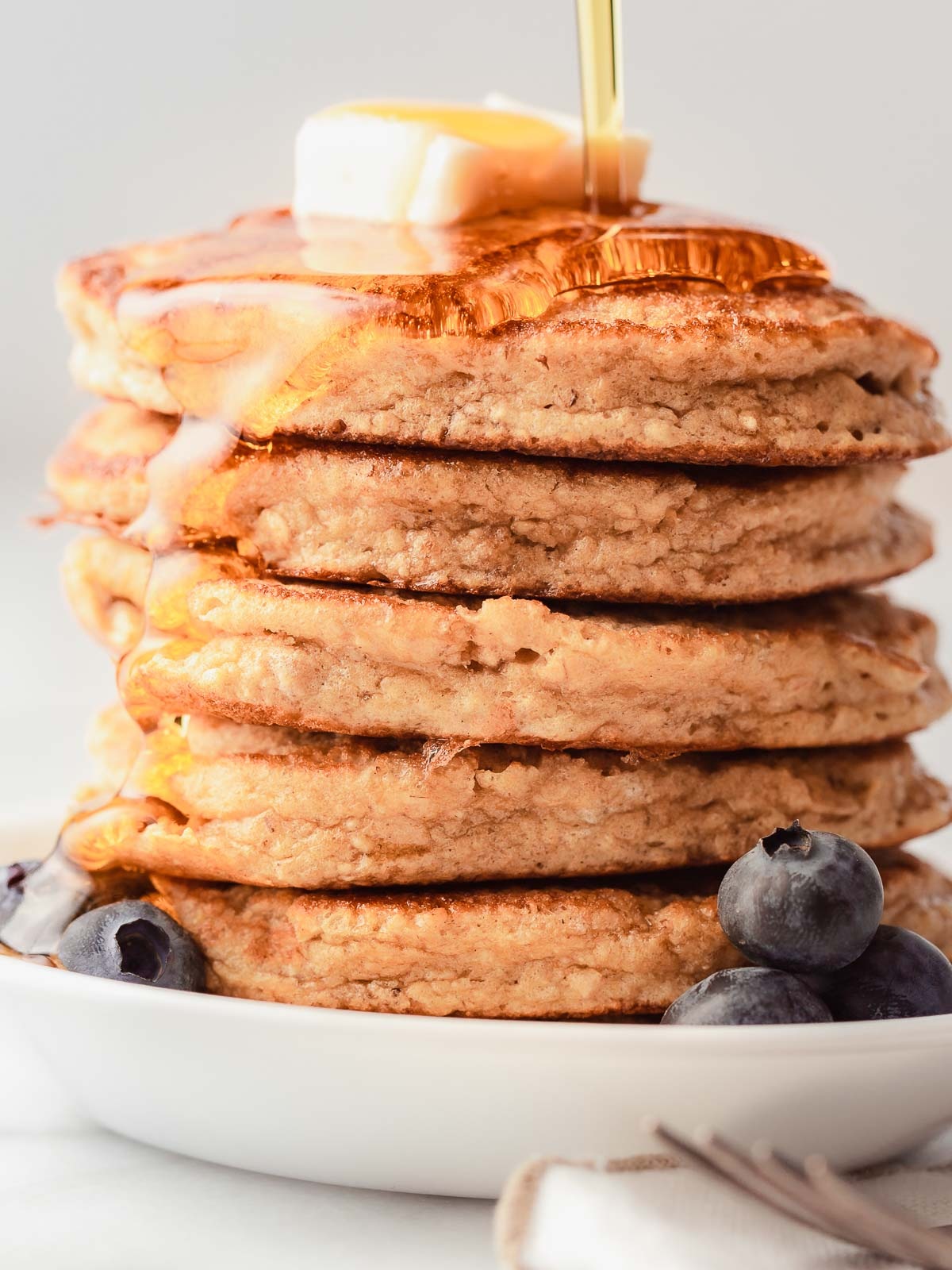 Fluffy protein pancakes stacked on a plate.