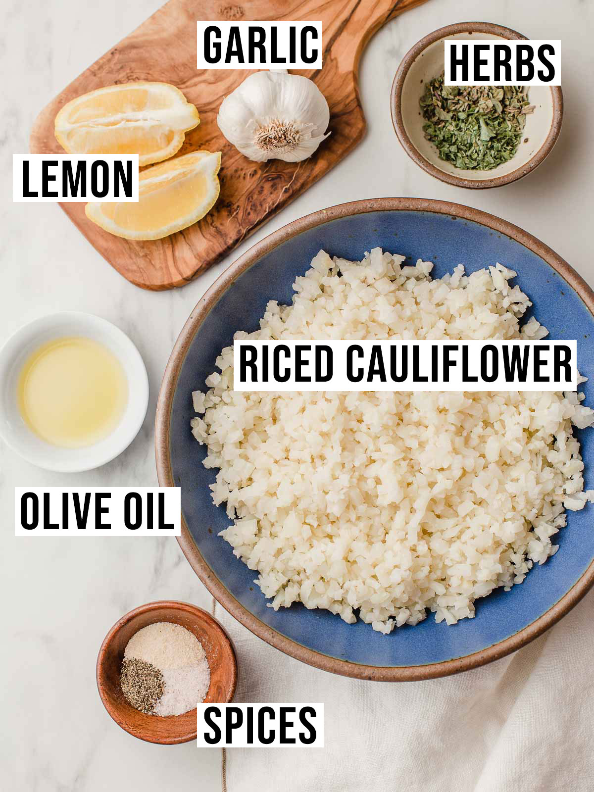 Greek cauliflower rice ingredients on a table.