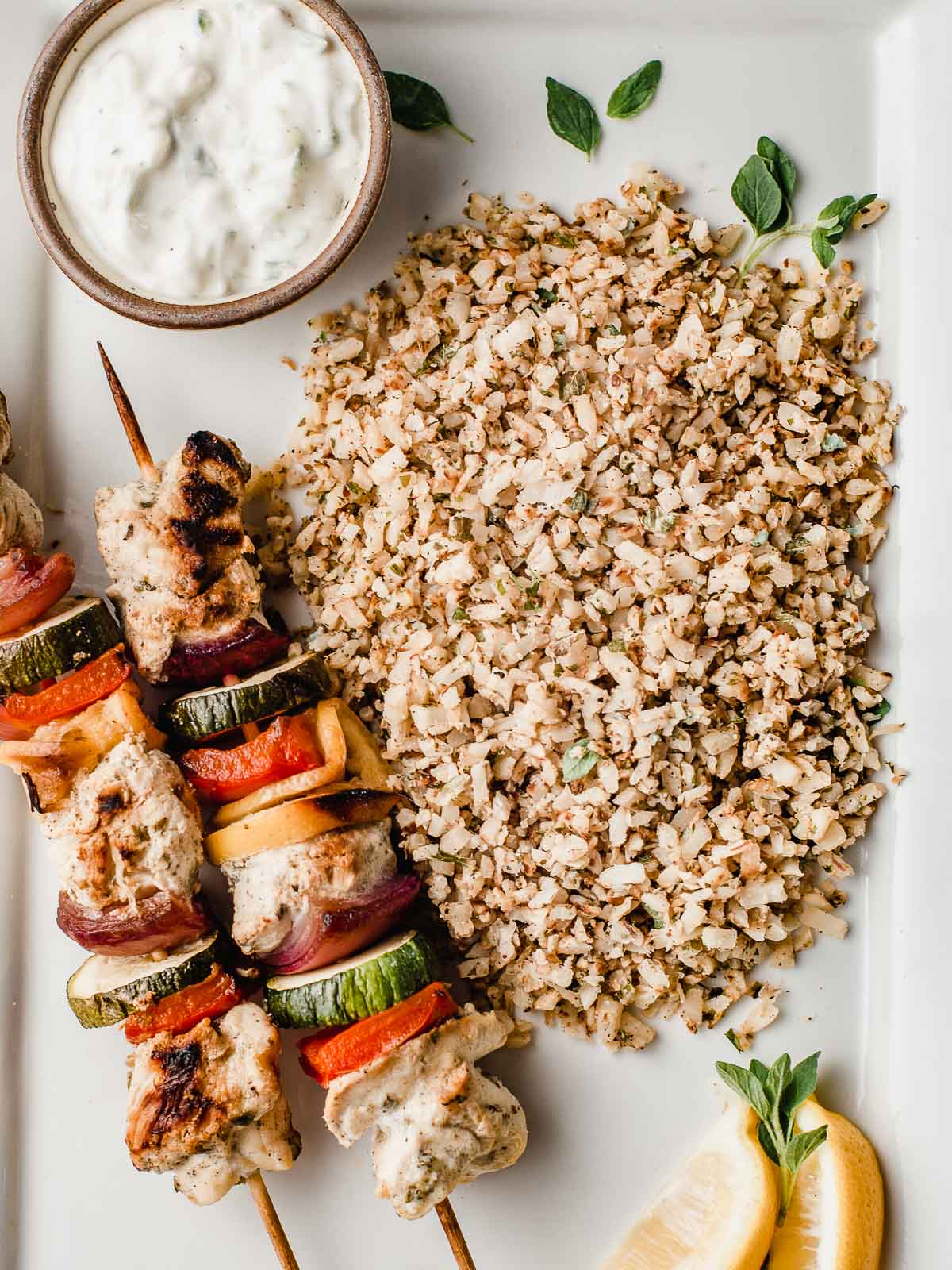 Greek cauliflower rice with chicken kabobs.