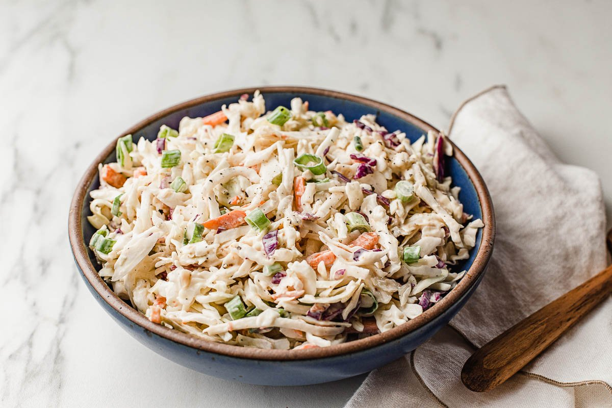 Low carb coleslaw in a bowl with a napkin.