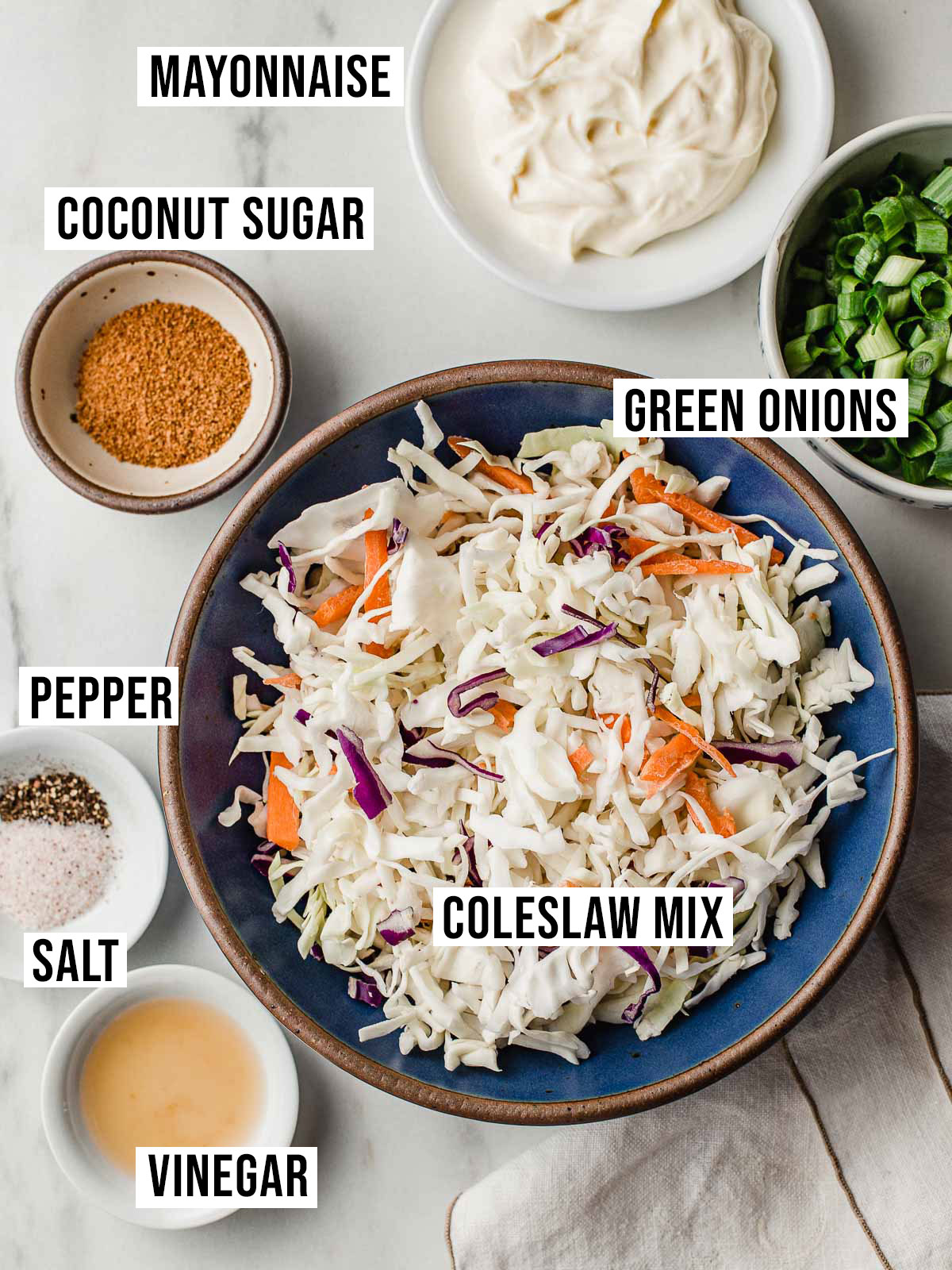 Low carb coleslaw ingredients on a table.