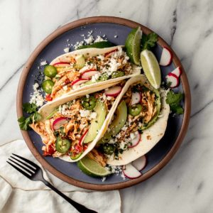 Instant Pot Chicken Tacos on a plate.