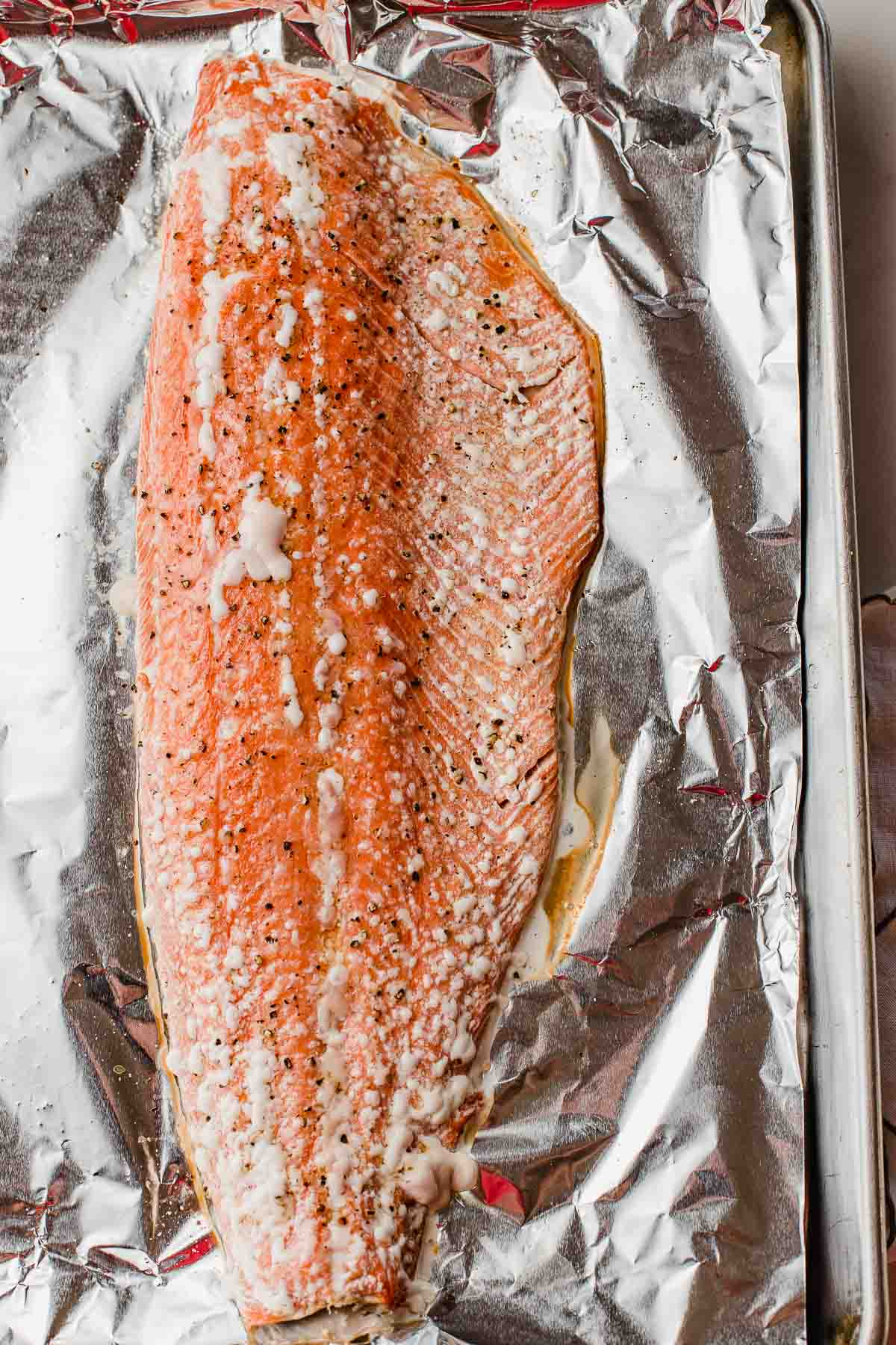 The salmon fillet after being taken out of the oven.